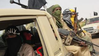 Ansar Dine militants at Kidal airport, northern Mali, 2012 photo