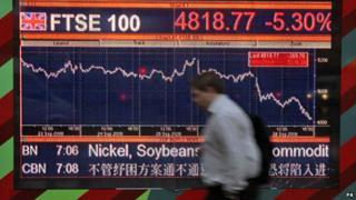 Man walks past FTSE 100 index display, 30 September 2008