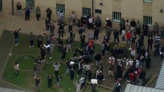 Detainees at Harmondsworth Detention Centre protesting in the exercise yard