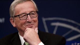 Jean-Claude Juncker gestures during a press conference on October 22, 2014