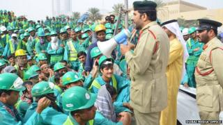 police addressing workers with a loudhailer