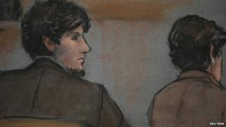 A courtroom sketch shows accused Boston Marathon bomber Dzhokhar Tsarnaev (L) in court on the second day of his trial at the federal courthouse in Boston, Massachusetts March 5, 2015