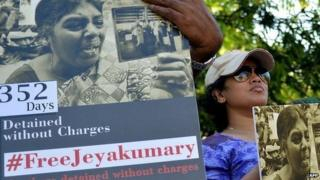 Sri Lankan activists hold placards demanding the release of Tamil woman, Jeyakumari Balendran who is being held by authorities under anti-terror laws for close to a year without trial,