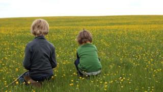 Anon children in field