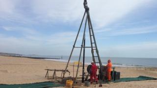 Drilling borehole on Bournemouth beach