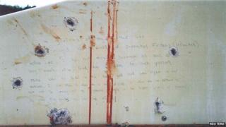 Blood-stained message prosecutors say Boston Marathon bombing suspect Dzhokhar Tsarnaev wrote on inside of a boat.