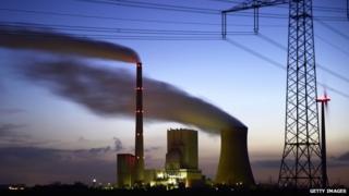 Steam rises from cooling towers at the coal-fired Kraftwerk Mehrum power plant at Haemelerwald