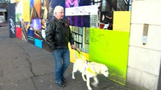 James Cosgrove with his guide dog