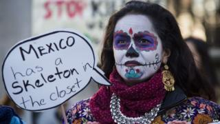 A protester demonstrates outside Downing Street in central London on March 3, 2015 over the abduction of 43 students in Mexico over four months ago, on the first day of Mexican President Enrique Pena Nieto's state visit to Britain