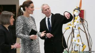 Catherine, Duchess of Cambridge looks at a sculpture