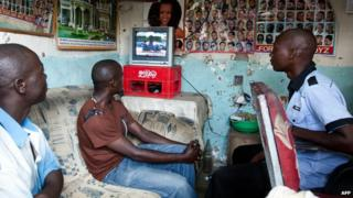 Kenyans watching a TV political debate in a Mombasa barber shop - February 2013
