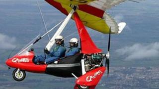 A red and yellow microlight