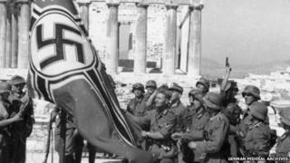 German soldiers raising the German war flag over the Acropolis