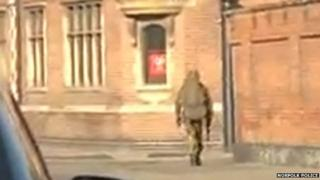 Man appearing to carry firearm