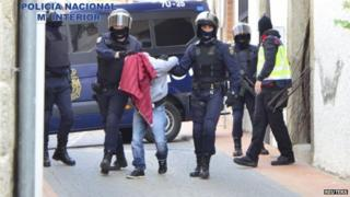 Spanish police arrest one of the eight suspects. Photo: 13 March 2015