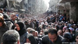 Residents of Syria's besieged Yarmuk Palestinian refugee camp, south of Damascus. File photo