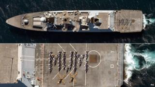 "Crew members of HMS Dauntless, on duty in the Gulf, spell out ""Mum"" in a Mother's Day message"