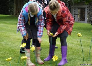 Pupils with ceramic daffodils at Uppark House
