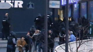 Police rescuing hostages from supermarket, 9 January 2013