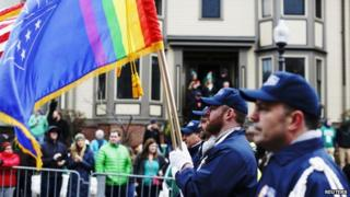 The colour guard for LGBT veterans group OutVets marches down Broadway during the St. Patrick's Day Parade in Boston 15 March 2015