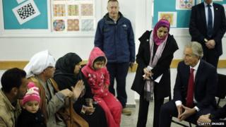 Middle East Quartet envoy Tony Blair visits a UN-run school sheltering Palestinians, whose houses were destroyed by what they said was Israeli shelling during the 50-day war last summer, in Gaza City on 15 February, 2015