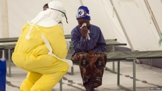 Health worker tends suspected Ebola patient in Sierra Leone