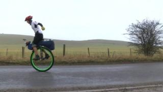 Ed Pratt on a unicycle