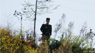 A North Korean soldier guards the border with China