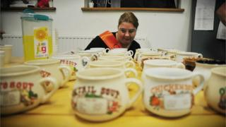 One of the team at Colchester Soup looking down the line of empty bowls