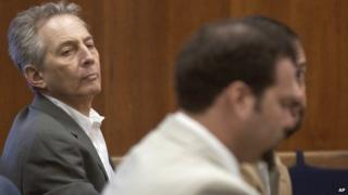 In this Aug. 18, 2003 file photo, Robert Durst, left, sits in a courtroom during a pre-trial hearing at the Galveston County Courthouse in Galveston, Texas.