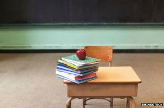 School desk with books and apple