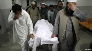 Relatives move the body of Samiullah Afridi body in hospital