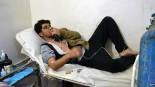 A young man uses an oxygen mask at a clinic after a suspected chorine attack in Sarmin, Idlib province, Syria (17 March 2015)