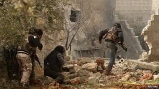 Rebel fighters in a village north of Aleppo in Syria