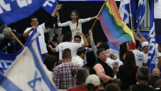 Supporters of Israeli Prime Minister Benjamin Netanyahu's Likud party react to exit poll figures as they wait for the announcement of the first official results of Israel's parliamentary elections on March 17, 2015