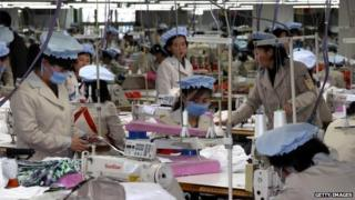 North Korean employees work at the assembly line of the factory of South Korean company at the Kaesong industrial complex on December 19, 2013 in Kaesong,