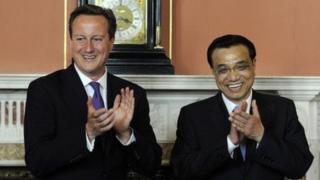 Britain's Prime Minister David Cameron (L) and Chinese Premier Li Keqiang applaud