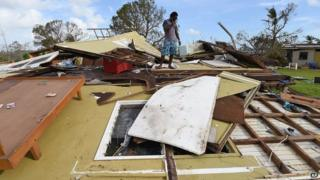 Adrian Banga surveys his destroyed house in Port Vila, Vanuatu in the aftermath of Cyclone Pam Monday, 16 March 2015