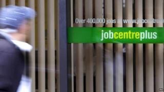 a man walks past a job centre