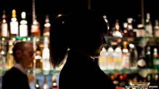 Bartender carrying a cocktail