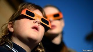 Children watch partial solar eclipse in Australia in 2013