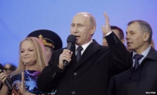 Russian President Vladimir Putin addresses crowd at Kremlin (18 March)