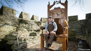 Sculptor Paul Clarke with his 9ft Eisteddfod chair