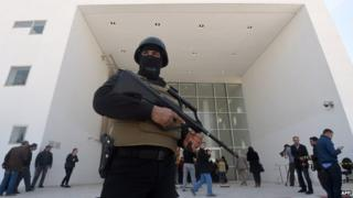 Tunisian security forces stand guard outside the National Bardo Museum in Tunis. 19 March 2015