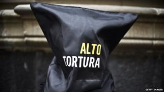 Activists of Amnesty International demonstrate against torture in Mexico on 4 September, 2014, in Mexico City