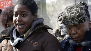Erica Garner, left, daughter of chokehold death victim Eric Garner, and his mother Gwen Carr, talk to the press after attending a court hearing, in the Staten Island borough of New York 5 February 2015