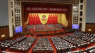 Delegates and officials conduct the closing of the Third Session of the 12th National Committee of the Chinese People's Political Consultative Conference at the Great Hall of the People in Beijing, China, on 13 March 2015
