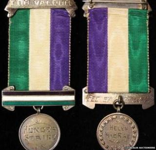 Front and back of Helen MacRae's Suffragette gallantry medal