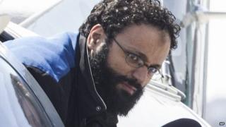 Chiheb Esseghaier, one of two suspects accused of plotting with al-Qaida in Iran to derail a train in Canada, arrives at Buttonville Airport just north of Toronto 23 April 2013