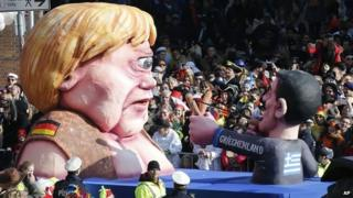 A carnival float depicting German Chancelor Angela Merkel as a mythical Cyclops and Greek premier Alexis Tsipras attacking her during the traditional Rose Monday carnival parade in Duesseldorf, Germany, 16 February 2015